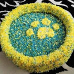 yellow and blue paw cat bed