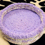 purple and cream cat bed