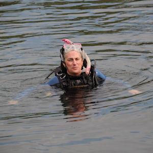 woman in scuba gear in lake