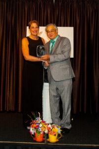 woman with man getting award