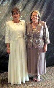 two women in formal wear