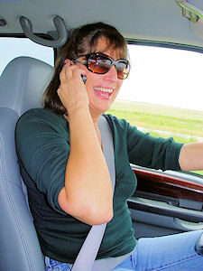 woman talking on phone sitting in the car