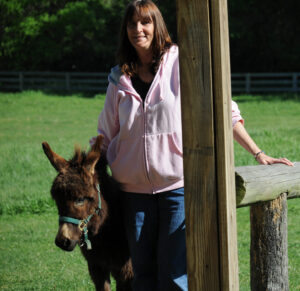 woman with mini-donkey